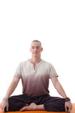 Attractive meditator man posing in lotus posture Royalty Free Stock Images