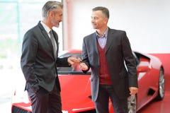 Attractive man buying car. Attractive men buying a car Royalty Free Stock Photos