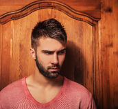 Attractive men indoor. Close-up photo. Stock Image