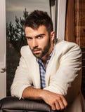 Attractive men indoor. Attractive man indoor. Close-up photo royalty free stock image