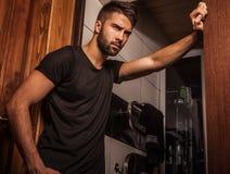 Attractive men indoor. Stock Photos