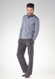 Attractive men in pyjamas smiling isolated on grey royalty free stock photography
