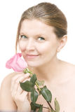 Attractive mid adult woman with a pink rose , female face of bea Royalty Free Stock Images