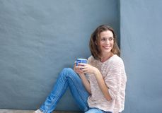 Attractive mid adult woman relaxing with a cup of coffee Stock Photography