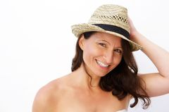 Attractive mid age woman smiling with summer style hat Royalty Free Stock Photography