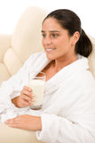 Attractive mid-aged woman drink milk for breakfast Stock Images