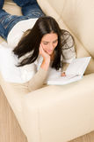 Attractive mid-aged woman read book on sofa Stock Photography