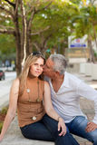 Attractive Middle Age Couple. Posing along Miami's Brickell Avenue in the late afternoon with trees and street in the background Stock Photo