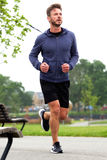 Attractive middle age runner in park Stock Photography