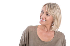 Attractive middle aged blond woman looking sideways to text. stock photo