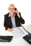 Attractive middle aged businesswoman at office Royalty Free Stock Photography