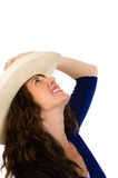 Attractive middle aged cowgirl in a white hat Stock Images