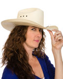 Attractive middle aged cowgirl in a white hat Royalty Free Stock Image