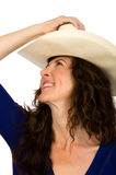 Attractive middle aged cowgirl in a white hat Royalty Free Stock Images