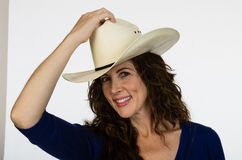 Attractive middle aged cowgirl in a white hat Stock Photography