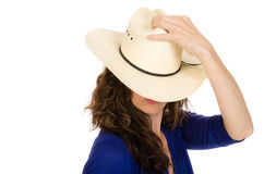 Attractive middle aged cowgirl in a white hat Stock Image