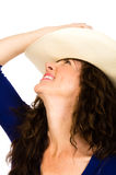 Attractive middle aged cowgirl in a white hat Royalty Free Stock Photos