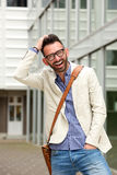 Attractive middle aged guy standing outdoors and laughing Royalty Free Stock Images