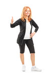 Attractive middle-aged sportswoman giving thumb up Royalty Free Stock Photos