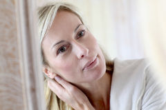 Attractive middle-aged woman applyinh cosmetics Royalty Free Stock Photo