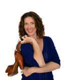 Attractive middle aged woman in blue blouse with shoes Royalty Free Stock Photo