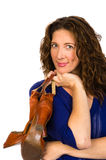 Attractive middle aged woman in blue blouse with shoes Stock Image