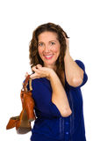 Attractive middle aged woman in blue blouse with shoes Royalty Free Stock Photos