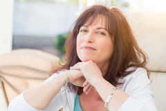 Attractive Middle Aged Woman Portrait. Attractive Middle Aged Woman Smiles On The Patio royalty free stock photography