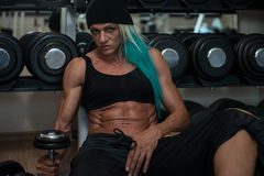 Attractive Middle Aged Woman Resting Relaxed In Gym Royalty Free Stock Photos