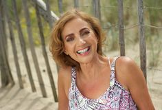 Attractive middle aged woman smiling outdoors Royalty Free Stock Photo
