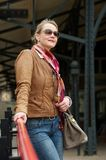 Attractive middle aged woman with sunglasses and bag Royalty Free Stock Photos