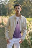 Young Arab Teen Model Posing in Nature at the Park. Attractive Middle Eastern Male Model Posing and Smiling for the Camera Outside Stock Images