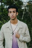 Young Arab Teen Model Posing in Nature at the Park. Attractive Middle Eastern Male Model Posing and Smiling for the Camera Outside Stock Photos