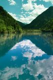 Mirror lake in Jiuzhai valley. The attractive mirror lake is one of most interesting place in the Jiuzhai valley. Before 8 am in the morning, the lake looks as Stock Photo