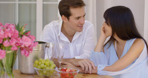 Attractive mixed couple having wine together Stock Images