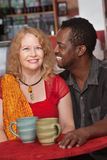 Attractive Mixed Couple in Restaurant. Attractive Black and white couple in restaurant Royalty Free Stock Photo