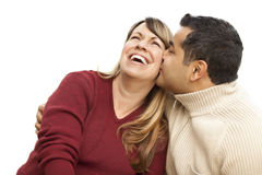 Attractive Mixed Race Couple Kissing on White. Attractive Mixed Race Couple Kissing Isolated on a White Background stock image