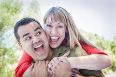 Attractive Mixed Race Couple Piggyback at the Park Royalty Free Stock Photography
