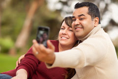 Attractive Mixed Race Couple Taking Self Portraits Royalty Free Stock Image