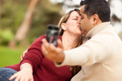 Attractive Mixed Race Couple Taking Self Portraits Stock Images
