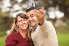 Attractive Mixed Race Couple Taking Self Portraits Royalty Free Stock Photos
