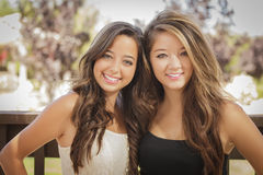 Attractive Mixed Race Girlfriends Smile Outdoors Royalty Free Stock Photo
