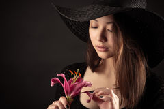 Attractive Mixed Race Korean Russian girl with lily flower Royalty Free Stock Images