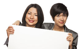 Attractive Mixed Race Mother and Daughter Holding Blank White Si Stock Image