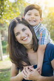Attractive Mixed Race Mother and Son Hug in Park Royalty Free Stock Image