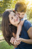 Attractive Mixed Race Mother and Son Hug in Park Royalty Free Stock Photos