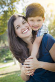 Attractive Mixed Race Mother and Son Hug in Park Royalty Free Stock Images