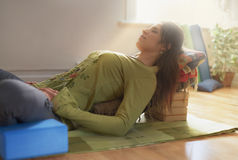 Attractive mixed race woman doing restorative yoga Stock Photos