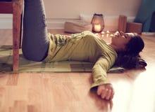 Attractive mixed race woman doing restorative yoga Stock Image