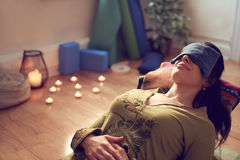 Attractive mixed race woman doing restorative yoga Stock Image